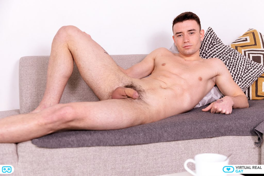 Simon Best young 18 years lad holding cock while naked on sofa